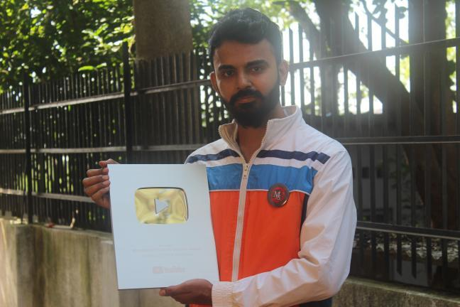 Awarded with Silver play button from youtube-one of the magical moment of his life.